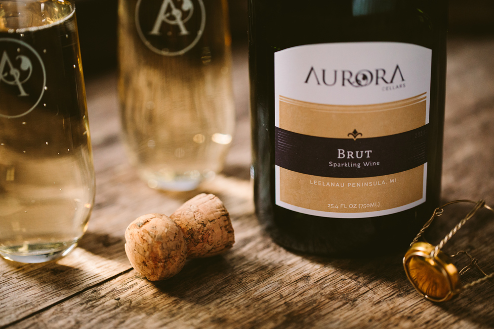 bottle and glass of sparkling wine from aurora cellars wine club