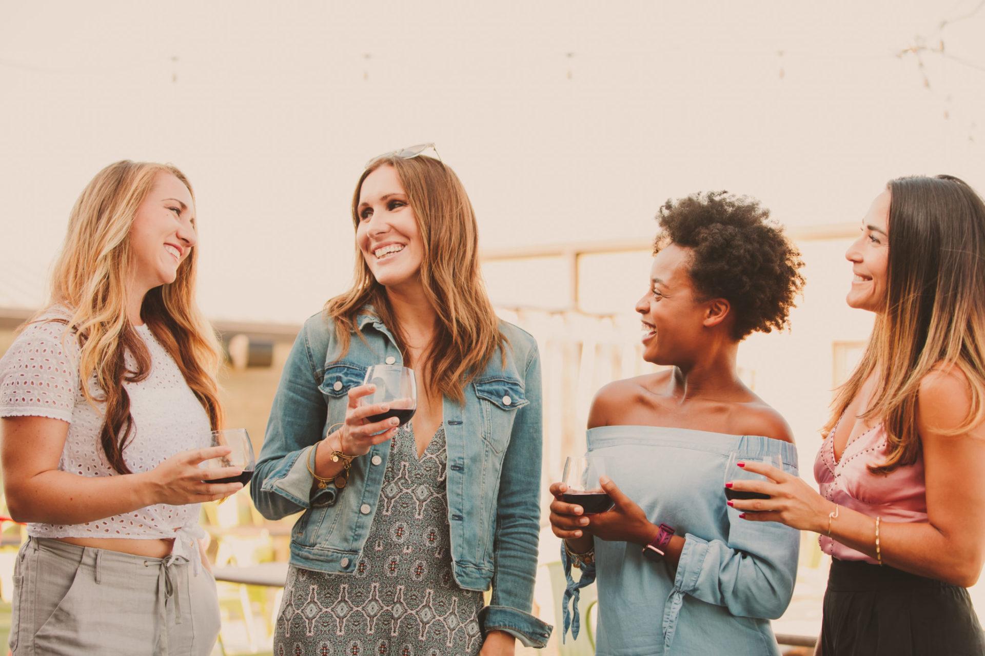 group enjoying aurora cellars wine at a tasting in traverse city